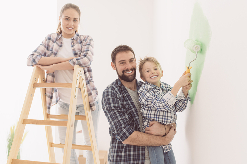 Family paints living room together
