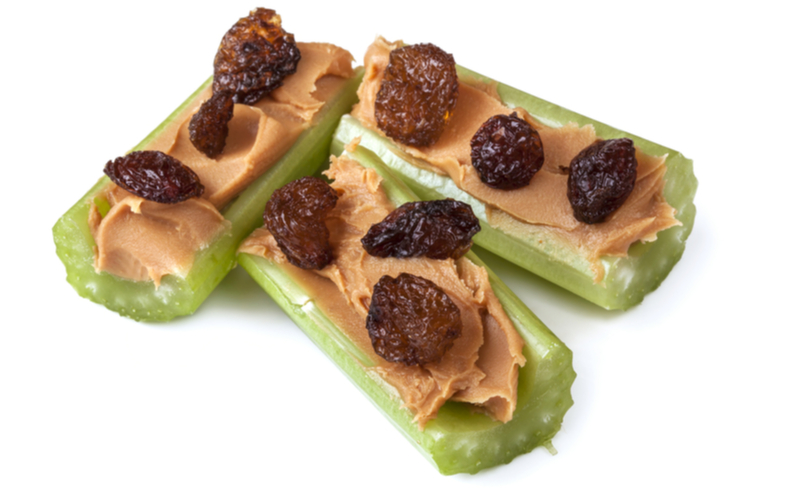 ants on a log, no-cook peanut butter filled celery boats, dotted with raisins