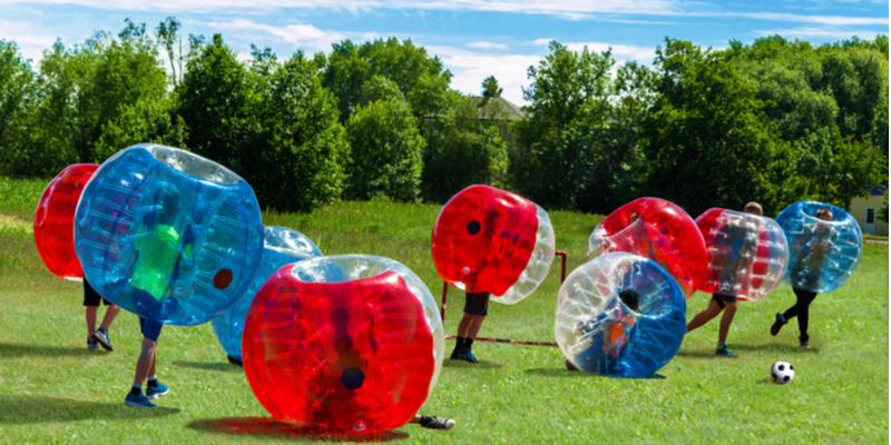 kids play bubble football
