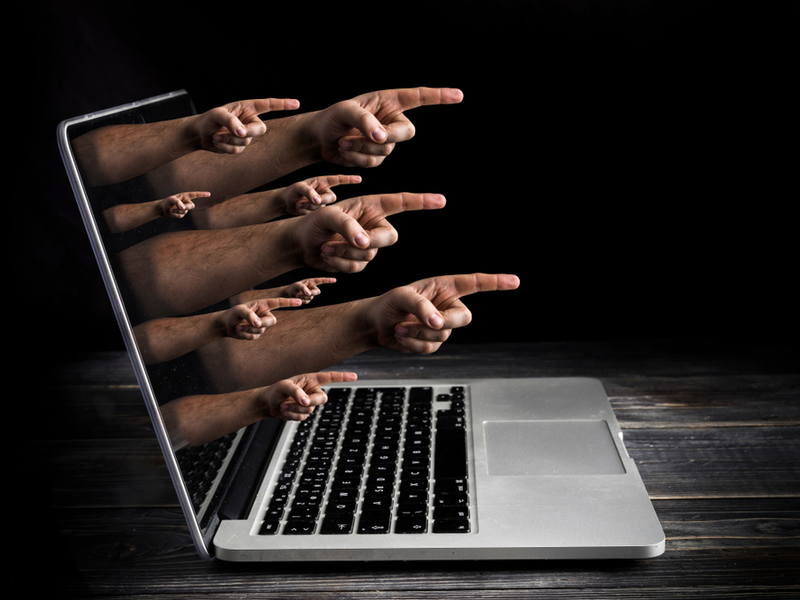 cyber bullying concept fingers screen blame