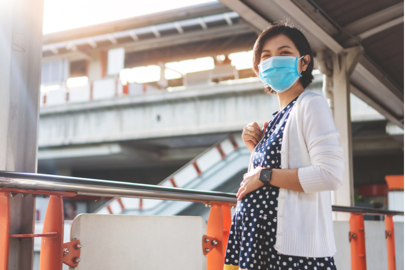 confident asian pregnant woman wearing face mask