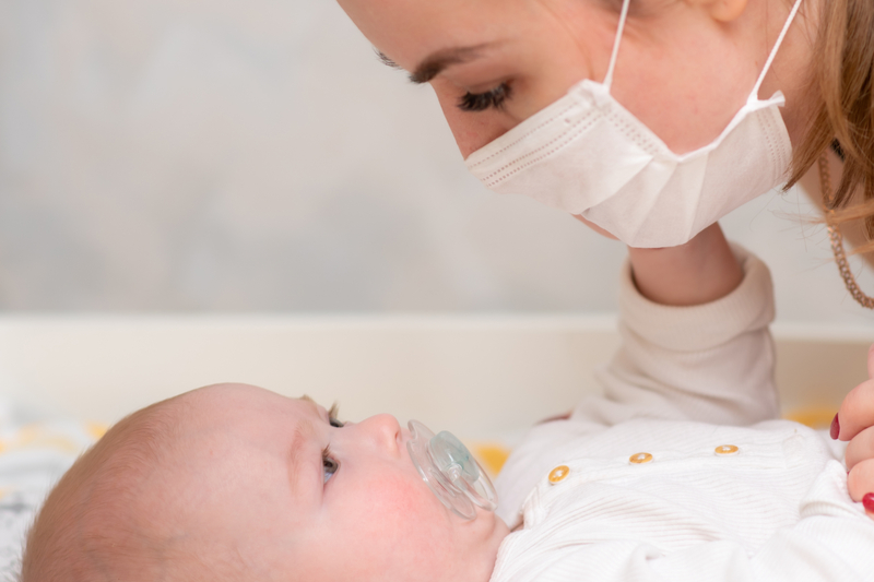 protective masks mean baby cannot read lips