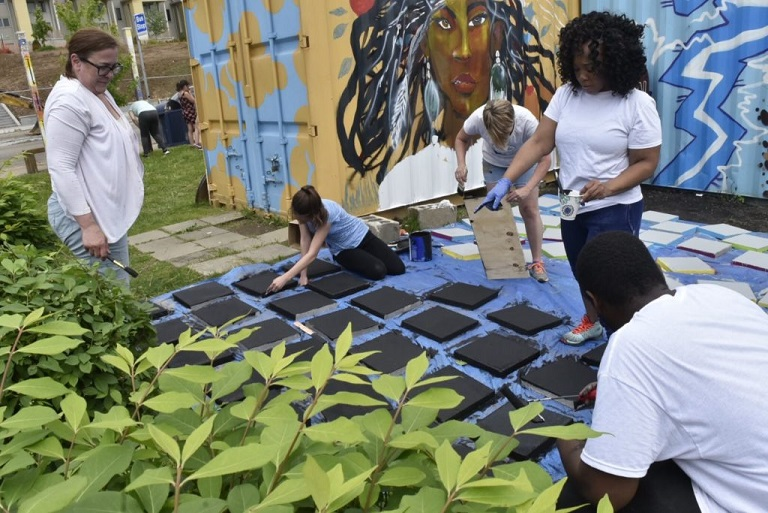 A family workshop at an outdoor community garden in Braddock, PA. (Photo credit: Ben Filio)