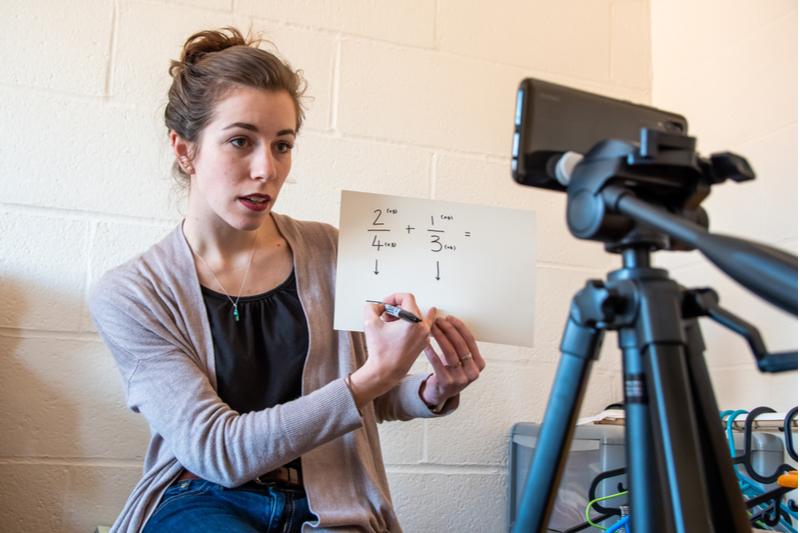teacher gives virtual math lesson