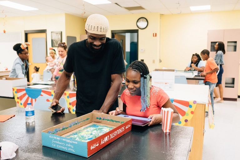 """Duquesne City School District hosts an """"Innovation Carnival"""" for students to teach their parents about the tech tools they use in class for Remake Learning Across America (Photo Credit: Ben Filio)"""
