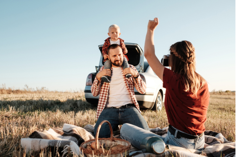 smile mom takes photo of special needs child during stop on road trip