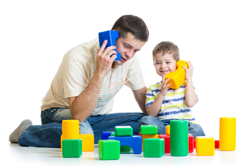 boy role plays telephone call with dad language disorders