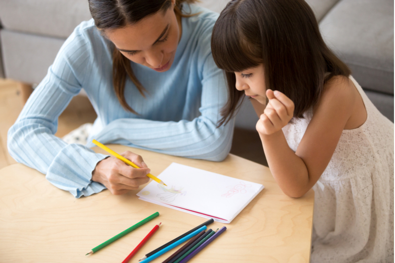 therapist works with little girl who has language disorders