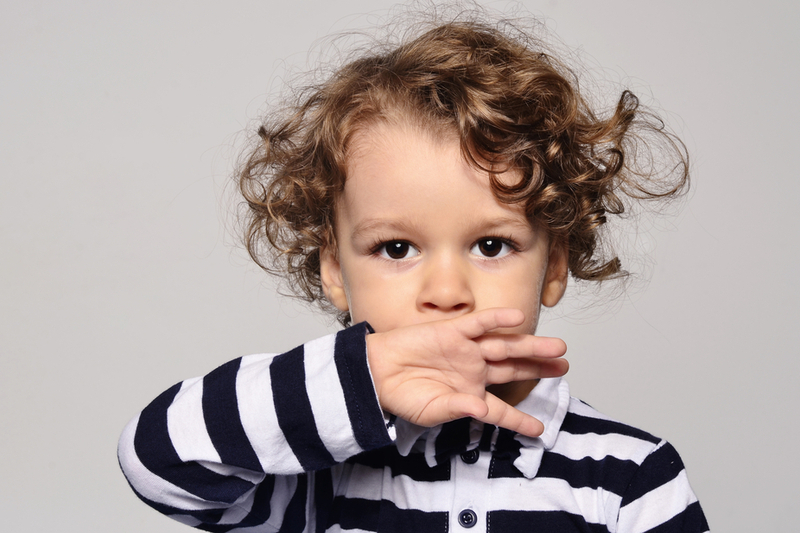 toddler holds hand over mouth represents language disorders