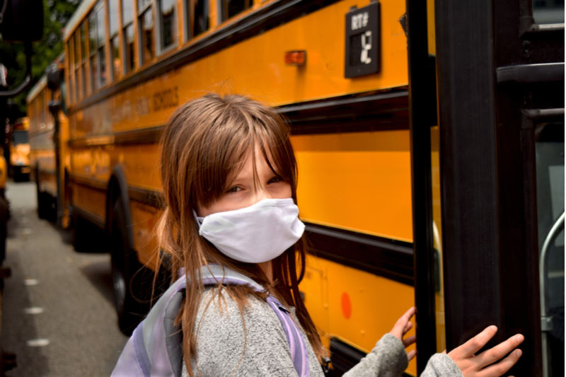 girl facing back to school fears ahead of boarding bus