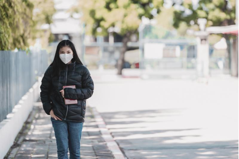 high school student walks alone