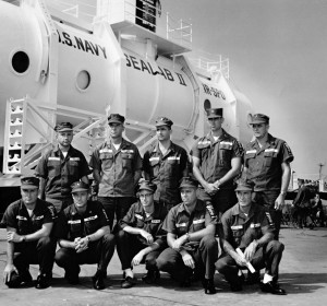 Sealab II aquanauts pose in front of the Sealab II habitat.