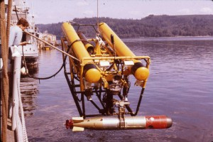 CURV II, built to perform torpedo retrieval operations, is lifted to the surface holding a recovered Mark 46 torpedo .