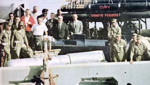 Navy personnel standing with a recovered hydrogen bom and ROV CURV I