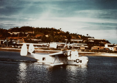 White bomber aircraft resting in the water