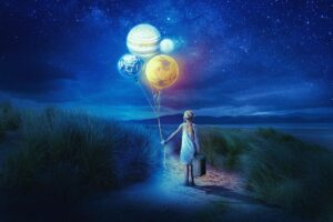 Girl holding the planets in her hands to inspire your to shift your perspective and be creative