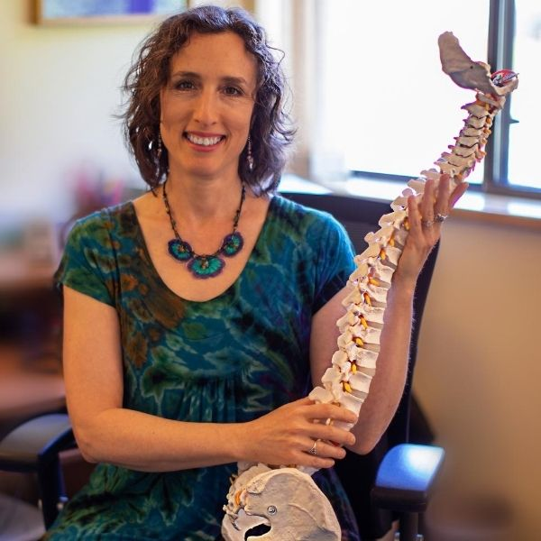 Dr Deborah Diamond D.S. explaining spinal injuries