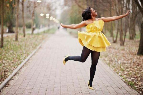 Happy Woman Twirling in the Air