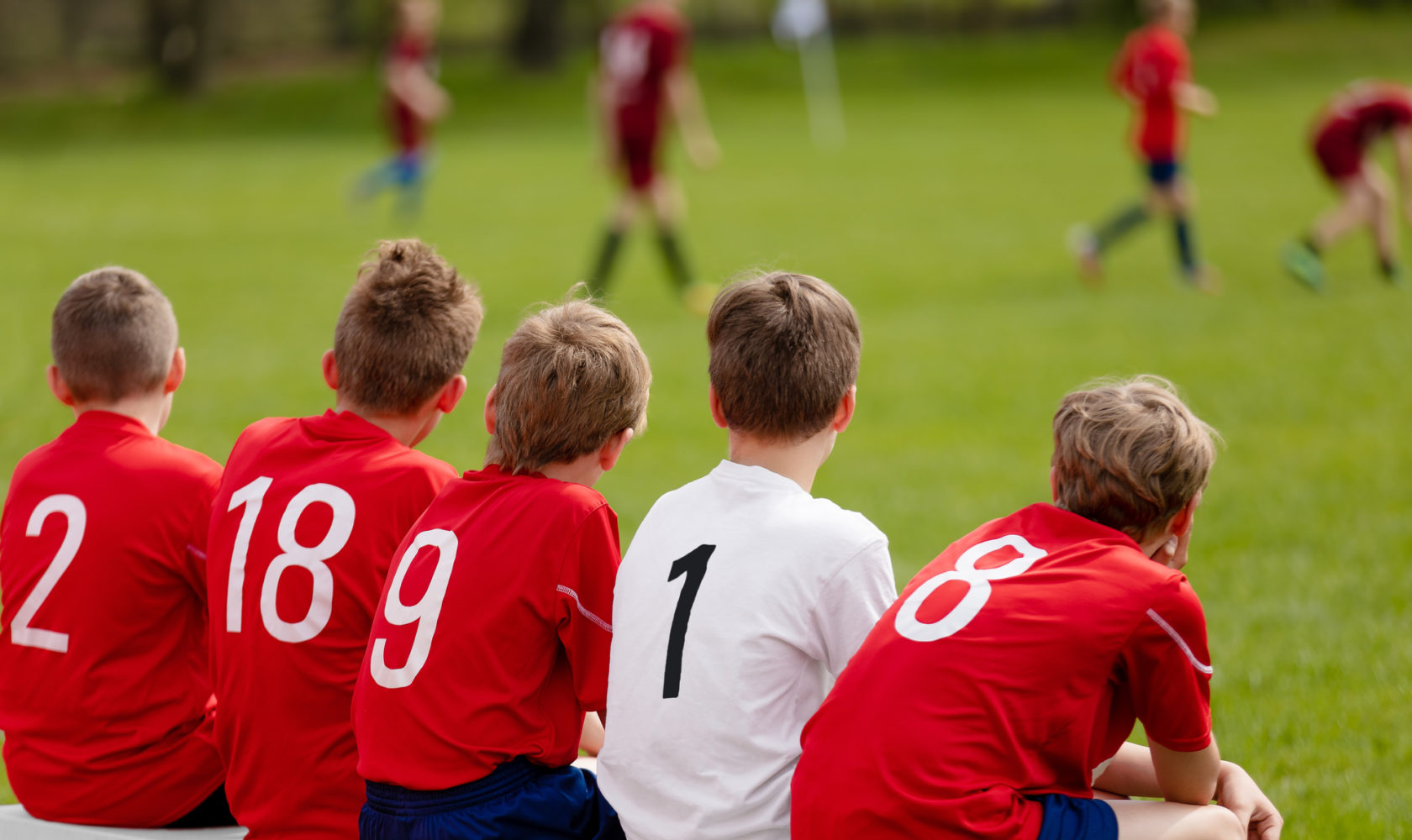 Kids Football Team. Children Football Academy. Substitute Soccer Players Sitting on Bench. Young Boys Playing European Football Game. Soccer Tournament Match for Children