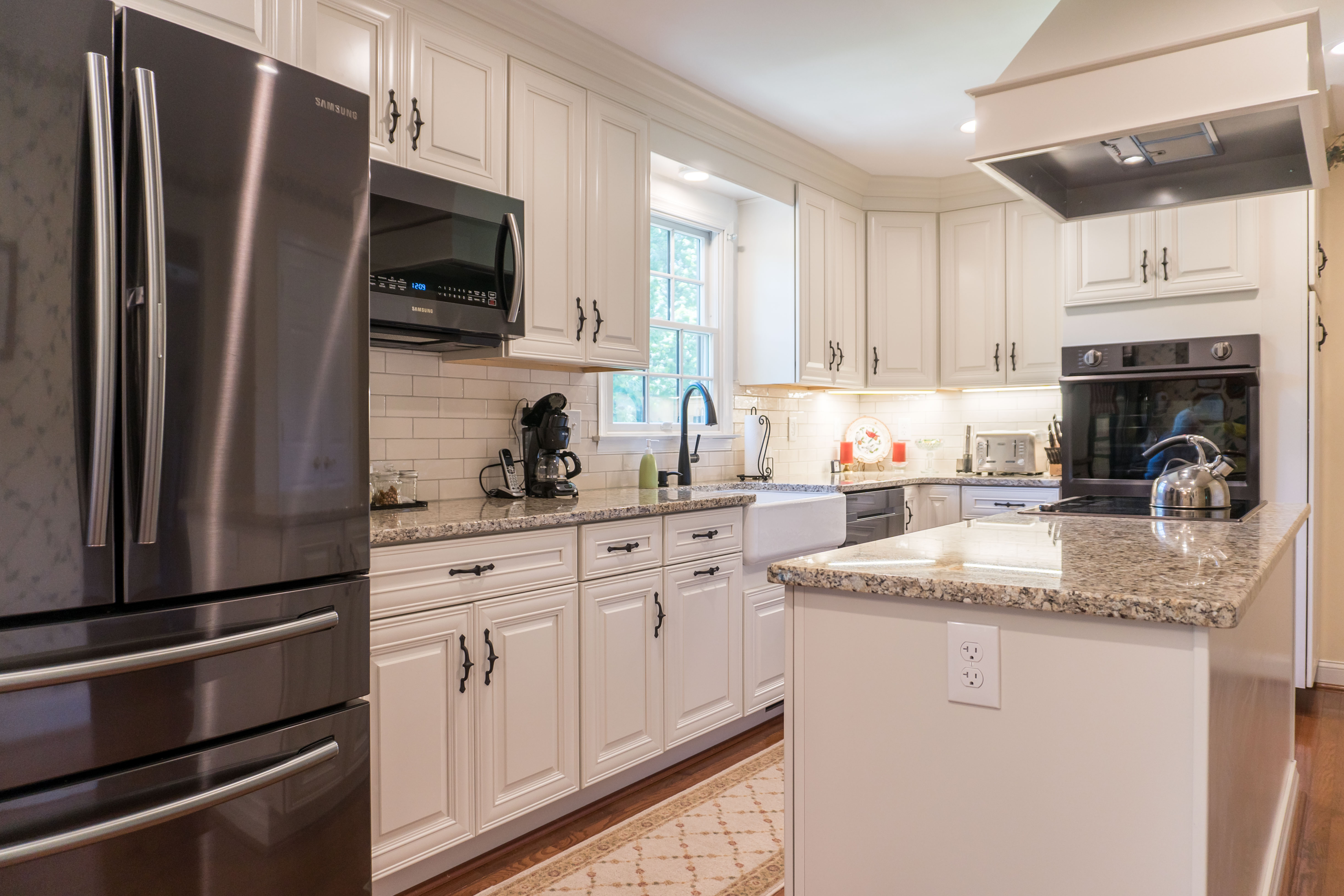 remodeled kitchen with island bar