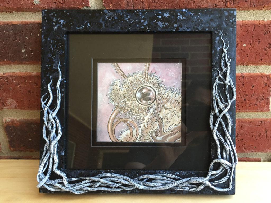 mothy-framed