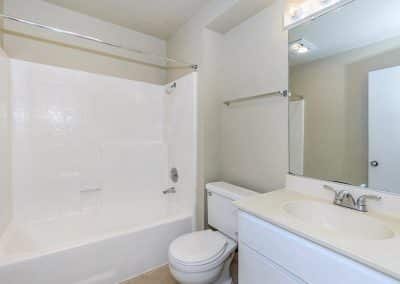 White bathroom with mirror