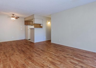Empty living room area with wood flooring