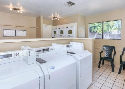 Laundry room with window and chairs for waiting