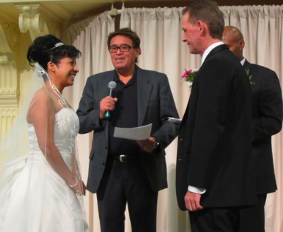 Elsa and John at their wedding. Rene Gallegos, outreach worker at UGM was officiating the ceremony in Spanish. Beside him is Jemal Damtawe, also an outreach worker at UGM, who officiated in English.