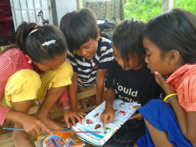 The children in Oudong Village are now using materials developed by Alongsiders International.