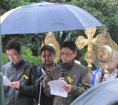 Ted Ng read scripture at the Ecumenical Prayer Rally for Peace and Human Rights in Hong Kong in front of the Chinese Consulate.