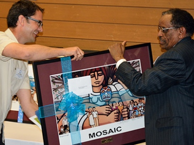 Loren Balisky representing Kinbrace as they received a Human Rights Award from MOSAIC.