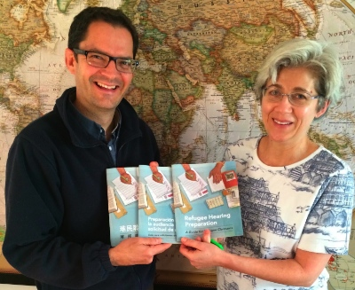 Loren Balisky and Fran Gallo with copies of the Refugee Hearing Preparation Guides.