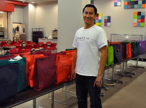 Sean Clark, co-founder of SHOEme, with last year's donation of shoes to UGM.