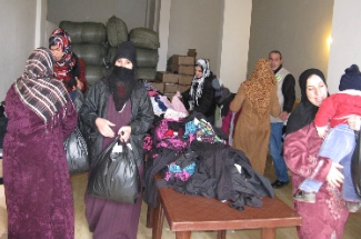 Clothing distribution for Muslim Syrian refugees in the south of Lebanon near Sidon.  Photo by James Grunau.