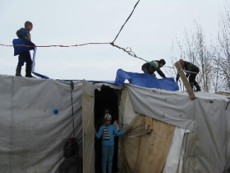 Tent repairs after a storm in the Bekaa Valley. Photo by James Grunau.