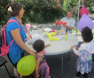 Pastor Fred Rink spent the afternoon making balloon animals for children at Bethlehem Lutheran Church's July 4 block party.