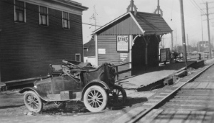 Collingwood Station [on the B.C.E.R.] Central Park line Photograph shows an automobile parked next to the station platform. 1930s AM336-S3-2-: CVA 677-386