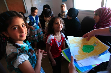 Refugee children from Syria at a clinic in Ramtha, northern Jordan. Photo by Russell Watkins, Department for International Development.
