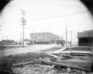 View of 41st Avenue, looking west from East Boulevard, probably in 1914. Photograph shows interurban line, municipal hall for Point Grey, and various businesses, including the Bank of British North America. Vancouver Archives: AM54-S4-: LGN 1012