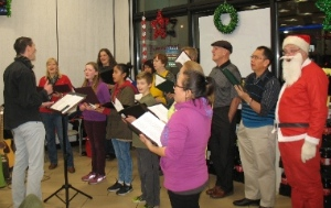 Pastor Paul Dirks leading members of New West Community Church singing Christmas carols at 7-Eleven Sapperton.