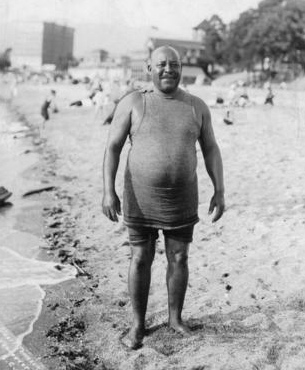 Joe Fortes on the beach in the West End. Photo by Stuart Thompson, about 1905. Vancouver Archives: AM336-S3-2-: CVA 677-440