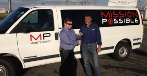 Mission Possible's Brian Postlewaite thanks Helijet CEO ***  *** for the van.