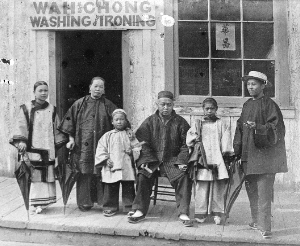 The Wah Chong family outside their laundry business on Water Street in 1884. Vancouver Archives: AM54-S4-: SGN 435.1
