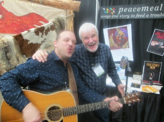 Russ Rosen (left) and Justyn Rees are always ready to perform, even at their Missions Fest booth.
