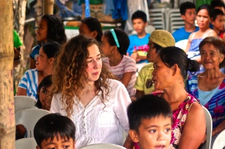 Rahel has been around the world on Logos Hope; here she is showing with local people in the Philippines.