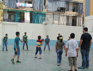 Dany Saab often plays dodgeball with the boys.