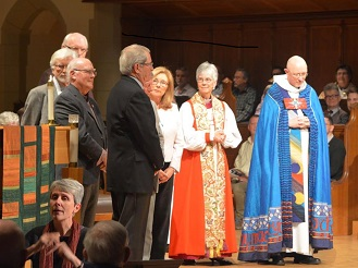 Bishop Melissa Skelton sought God's blessing in her prayer; to her right is rector and dean of Christ Church Cathedral, Peter Elliott. Photo by Randy Murray.