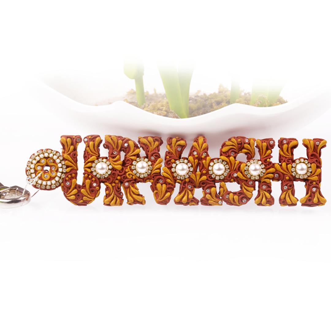 Urvashi Golden Bronze Pearl Name Keychain