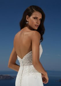 Stun your guests in this strapless sweetheart with intricate lattice and floral beading trickling into the top of the skirt. This crepe fit and flare adds confidence in your shape and features a chapel length train.